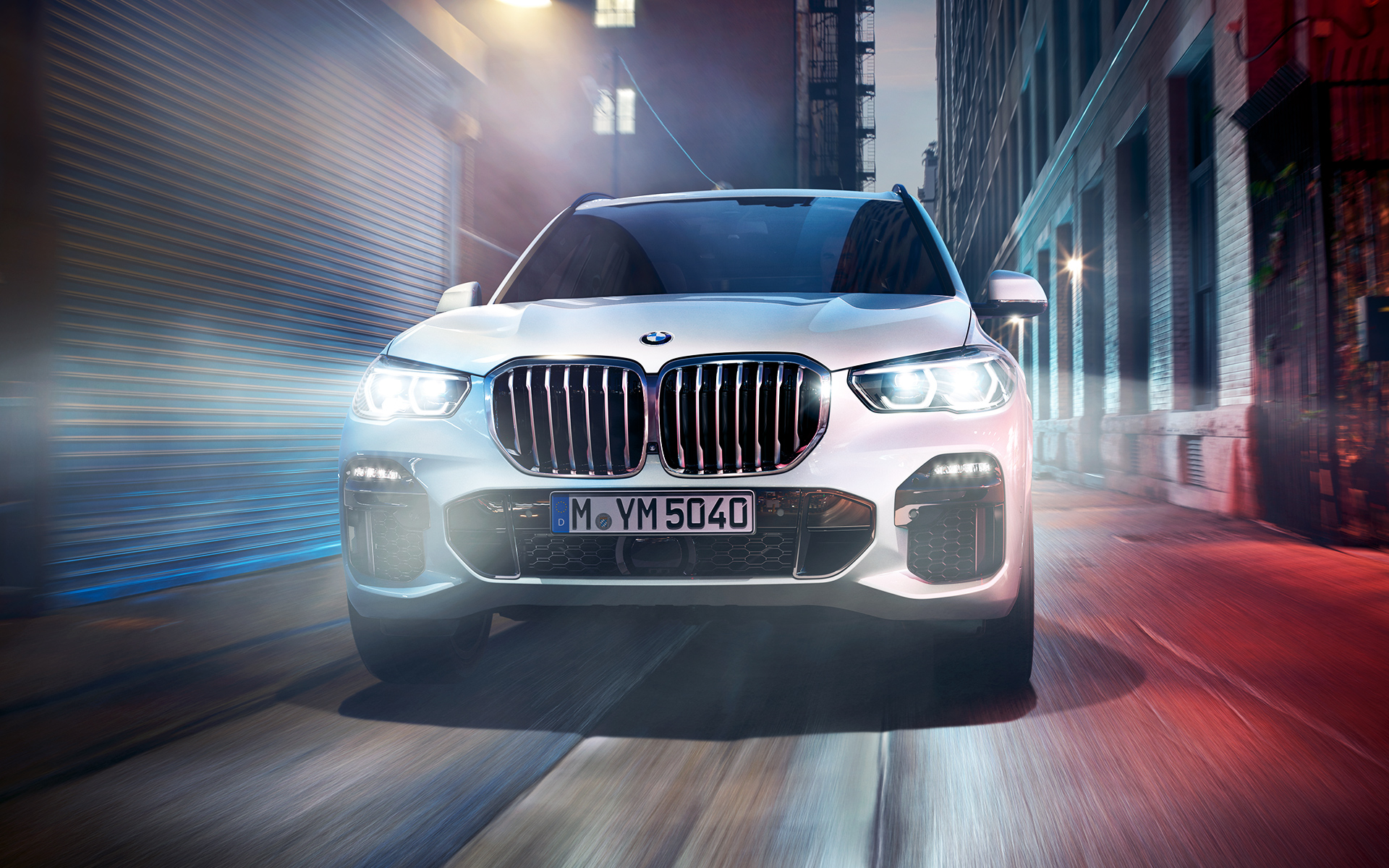 The BMW X5 on a street in the city at night